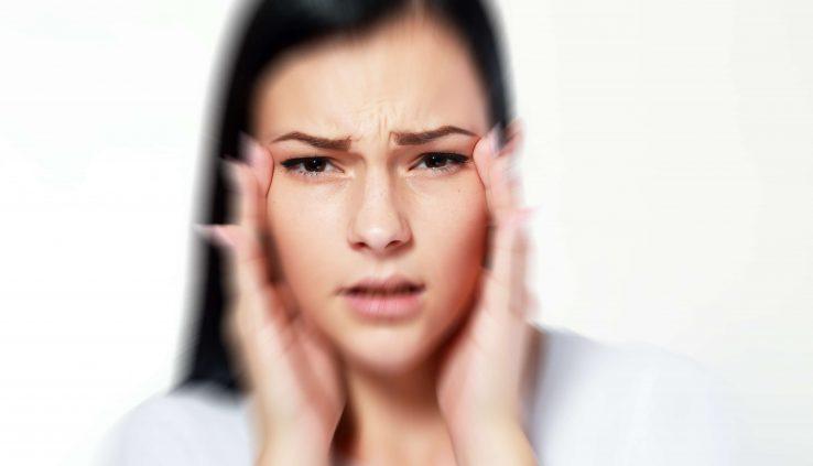 woman headache and blurry vision